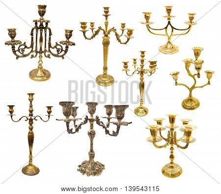 Set with various candle holders and candlesticks isolated on white