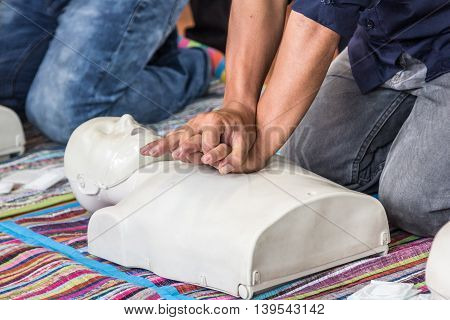 Trainning CPR and heart massage on white trainning doll