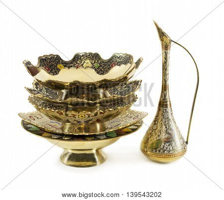 Indian traditional dishware with decorations isolated on white