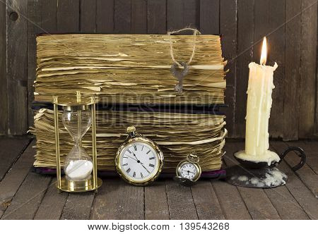 Still life with various watches, candle and old book