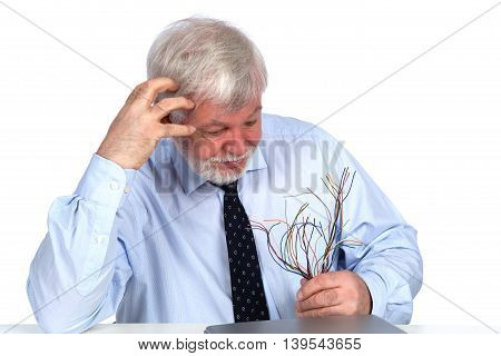 Perplexed Man with cables in hand isolated on white background