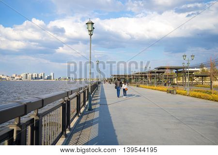 KAZAN, RUSSIA - APRIL 30, 2016: The modern embankment of the Kazanka river, april day. Tourist landmark of the city Kazan, Tatarstan