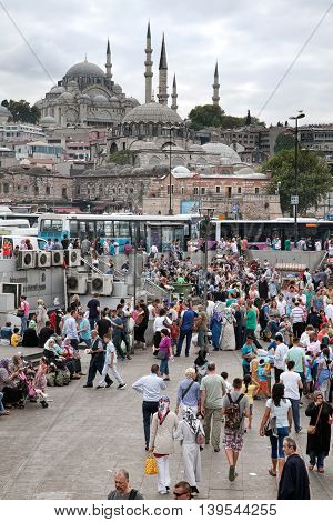 Istanbul Turkey - September 1 2014: People walking across the square to the bus stop at the background the Sultan Ahmed Mosque in the centre of Istanbul.