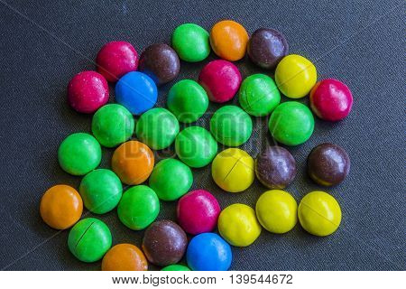 Multicolor Bonbon Sweets (ball Candies) On A Black Background