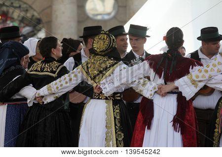 ZAGREB, CROATIA - JULY 22: Members of folk group Cvelferi from Zupanjska Posavina, Croatia during the 50th International Folklore Festival in center of Zagreb, Croatia on July 22, 2016