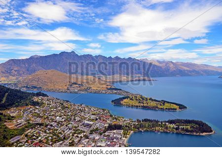 Scenic view of Queenstown and surrounding rugged mountain range (The Remarkables) on the shores of the glacial Lake Wakatipu, New Zealand