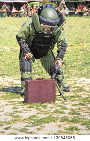 LAUDUN, FRANCE - MAY 01, 2014:  Bomb Squad specialiste and vehicle equipped with a remote-controlled robot detection and detonation equipment during French Foreign legion open Day on May 01, 2014