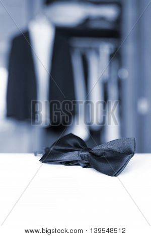 Bow tie. Open closet and tuxedo. Getting ready for formal night. With isolated place for text.