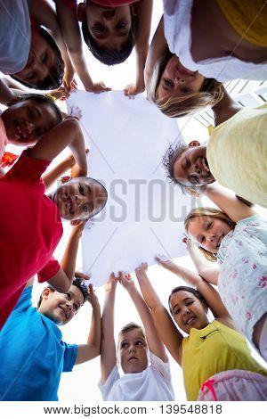 Portrait of smiling children holding cloth