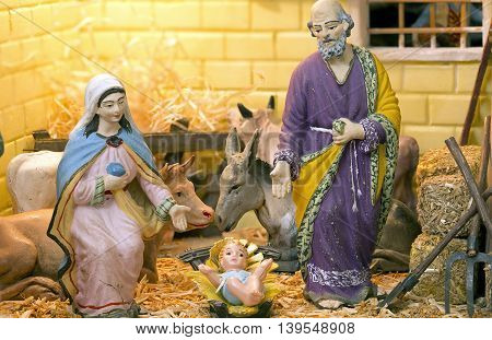 Christmas Nativity scene with figurines in a crib