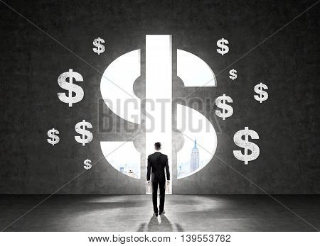 Businessman in suit standing in front of wall with dollar signs looking at New York city.