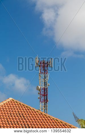 Cell Tower Over Tile Roof on Bonaire