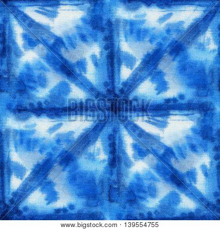 Seamless tie-dye pattern with circles of indigo color on white silk. Hand painting fabrics - nodular batik. Shibori dyeing.