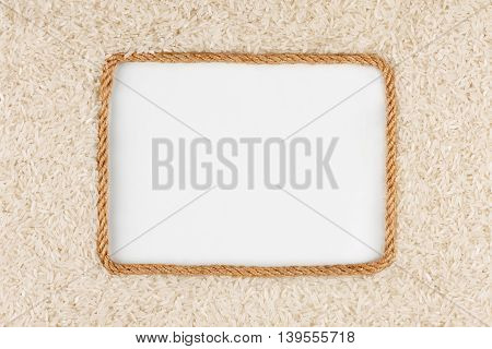 Frame made of rope with rice grains and a white background with space for your text