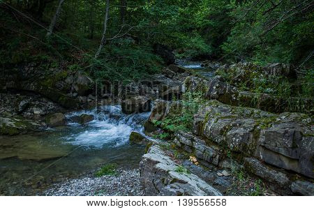 Small beautiful waterfall with very clear water