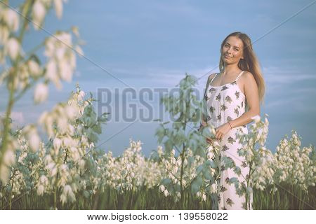 Princess. Young Beautiful Pretty Woman Posing In Long Evening Luxury Dress Against Bushes With White