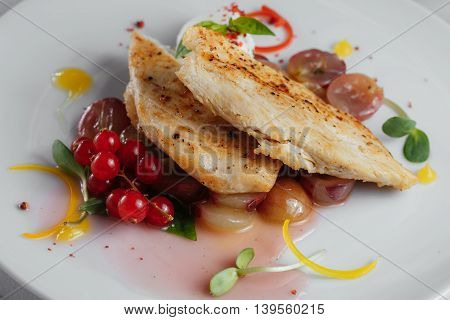 Chicken Fillet With Grapes And Red Currant Closeup