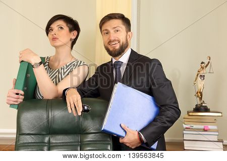 business partners lawyer in the office holding documents