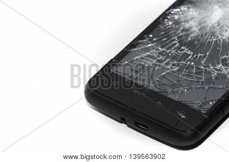 Smartphone with a shattered screen. Dropped phone, insurance claim