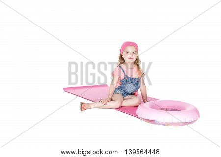 Portrait of happy child with inflatable rubber circle having fun. isolated white background