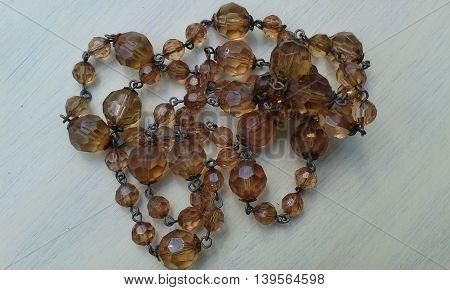 Junk broken costume jewellery necklace sun faded