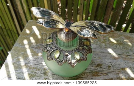 Vintage opaque green glass perfume bottle with butterfly and ornate detail