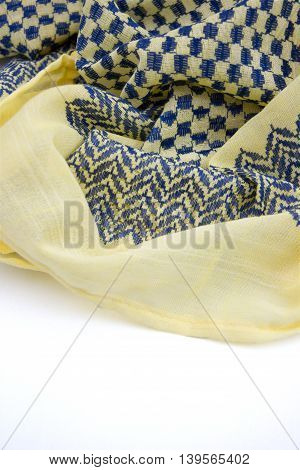Yellow arabic scarf isolated on white background