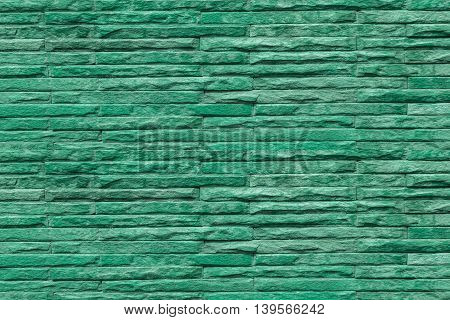 Background pattern of stone wall made with blocks.
