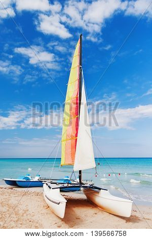 Colorful catamarans on sandy Varadero beach. Bright sunny day on Cuba.