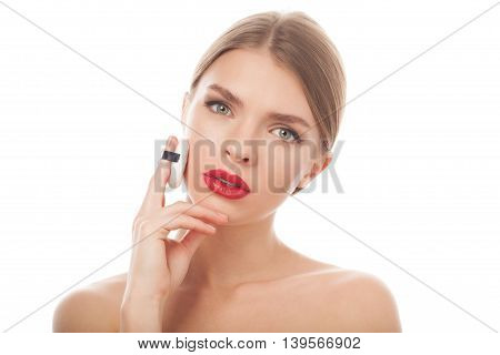 closeup portrait of a beautiful woman with beauty face and clean skin applying sponge