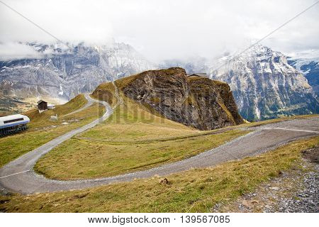 a winding road in hiking trail of First, Switzerland