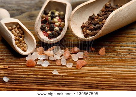 various spices on wooden table