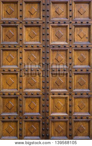 Detail of the traditional old door from Siena Italy
