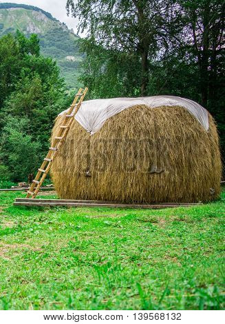 Bale of hay with wooden letters on it