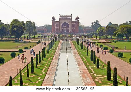 AGRA, INDIA - OCTOBER 18, 2008: view on entrance to Taj Mahal complex in Agra, India. It was commissioned in 1632 by the Mughal emperor Shah Jahan (reigned 1628-1658) to house the tomb of his favorite wife Mumtaz Mahal