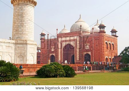 AGRA, INDIA - OCTOBER 18, 2008: Unidentified people are visiting Taj Mahal Jawab, Agra, India.The Taj Mahal complex consists of a number of buildings including the iconic white masoleum