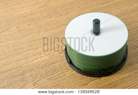 Bundle of Silver CD or DVD Compact Disc on A Wooden Table.