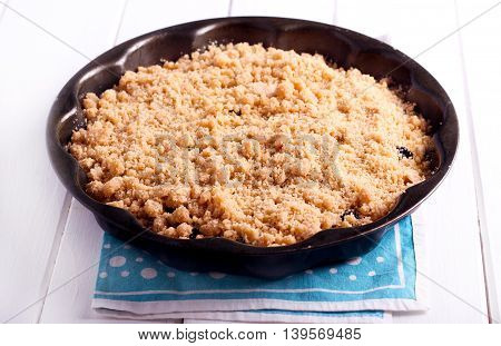 Streusel topping cake in a tin before baking