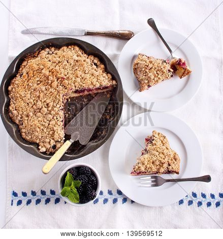 Blackberry crumble topping cake sliced on plate top view