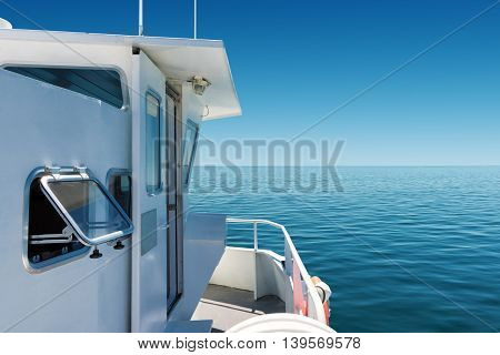 on board of a passenger boat navigating on calm blue sea