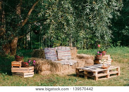 chair without backrest made from straw, outdoor furniture, cowboy party