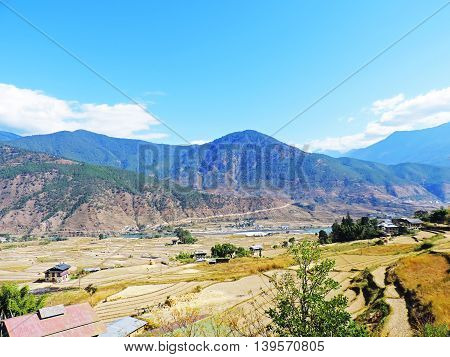 Landscape of mountain and fields in Bhutan