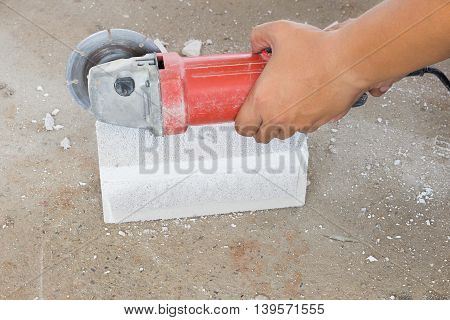 Home building wall cutting bricks in construction sites by using the tool specialists.