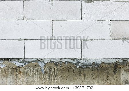 Home building construction of the wall white brick on beam