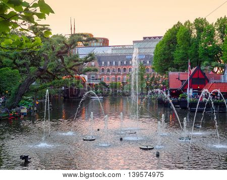 idyllic evening scenery with lake and fountain in Copenhagen the capital city of Denmark