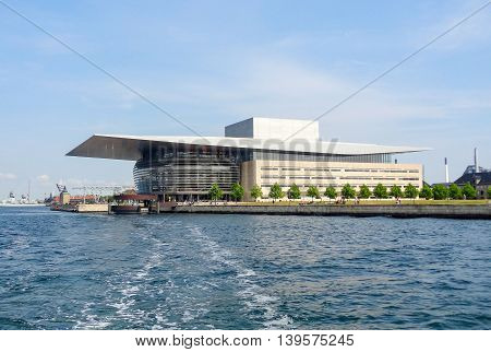 waterside scenery with Copenhagen Opera House in Copenhagen the capital city of Denmark