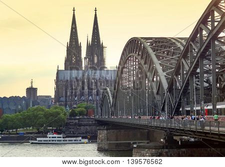 waterside scenery with cologne cathedral and hohenzollern bridge in Cologne a city in North Rhine-Westphalia in Germany at evening time