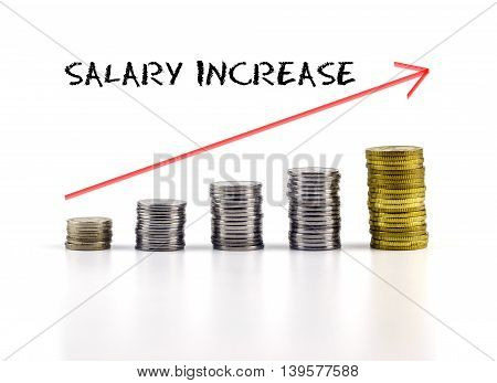 Conceptual Image. Stacks Of Coins Against White Background With Red Arrow And Salary Increase Words.