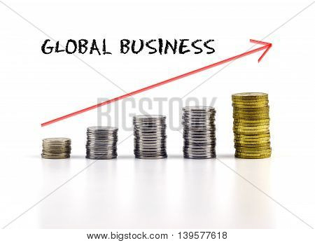 Conceptual Image. Stacks Of Coins Against White Background With Red Arrow And Global Business Words.