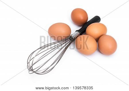 Hen eggs and eggbeater on white background